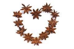 Chinese Star Anise, Star Anise, Star Aniseed, Badiane, Badian, Badian Khatai, Bunga Lawang, Thakolam, arranged in a heart shape. Stock Images