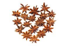 Chinese Star Anise, Star Anise, Star Aniseed, Badiane, Badian, Badian Khatai, Bunga Lawang, Thakolam, arranged in a heart shape. Chinese Star Anise, Star Anise stock images