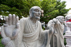 Chinese statue in the Buddhist temple. Stock Photos