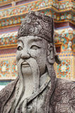 A Chinese statue in the courtyard of the Buddhist temple of Wat Stock Images