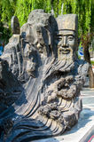 Chinese statue of old man carved in rock Stock Image