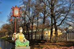 Chinese statue in park in pushkin in autumn Royalty Free Stock Images