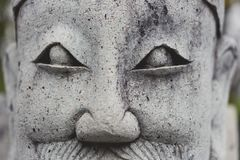 Chinese statues carved from stone. Closeup face of the sculpture.  Stock Photos