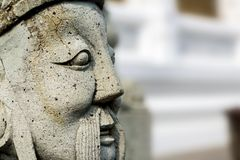 Chinese statues carved from stone. Closeup face of the sculpture. With copy space for your text Stock Images