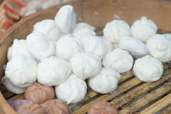 Chinese steamed bun. Baozi or simply known as bao, pau, humbow, pow is a type of steamed, filled bun or bread item in Chinese cuisine Stock Image