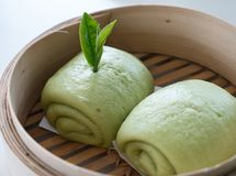 Chinese steamed bun with the green tree flavour. Stock Images