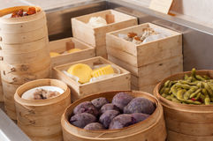 Chinese steamed bun and sweet creamy stuff. In bamboo ware Stock Images