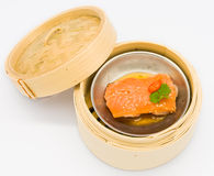 Chinese steamed dim sum salmon fish in bamboo container traditio Stock Images
