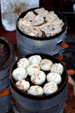 Chinese steamed dishes. A closeup of two bamboo steamers, one filled with buns and the other filled with dumplings. These Chinese dishes are collectively know as Stock Images