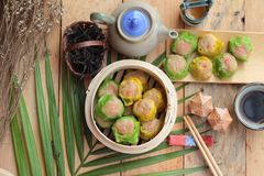 Chinese steamed dumpling and hot tea delicious. Royalty Free Stock Photo