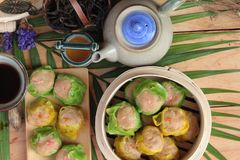 Chinese steamed dumpling and hot tea delicious. Royalty Free Stock Image