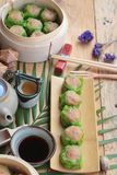 Chinese steamed dumpling and hot tea delicious. Royalty Free Stock Images