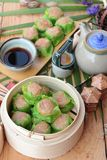 Chinese steamed dumpling and hot tea delicious. Stock Photos