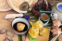 Chinese steamed dumpling and hot tea delicious. Stock Photography