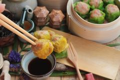 Chinese steamed dumpling and hot tea delicious. Stock Photo
