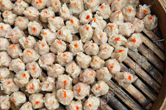 Chinese steamed food siu mai. Steamed Chinese shrimp siu mai in bamboo steamer Royalty Free Stock Images