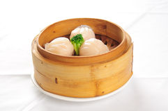 Chinese steamed meat buns. On the black plate Stock Photo