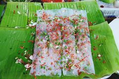Chinese Steamed Rice Noodle Rolls on banana leaf stock photography