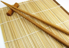 Chinese sticks 1. Two chinese sticks with bamboo cloth Stock Photo
