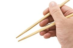 Chinese sticks. In hand on white Royalty Free Stock Photo