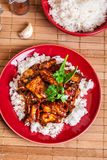 Chinese sticky pork sirloin roasted with a sweet and savory sauc. E served with boiled rice. Top view Stock Image