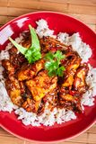 Chinese sticky pork sirloin roasted with a sweet and savory sauc. E served with boiled rice. Top view Royalty Free Stock Photos