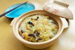 Chinese stir fry dish marrow & dried shrimps. A photograph showing a popular Chinese ethnic dish of stirfried sliced marrow gourd, with a variety of ingredients Royalty Free Stock Image