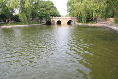Chinese stone arch bridge. In park Stock Photos