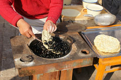 Chinese stone bread. Traditional Chinese cuisine, a flat bread baked on hot stones Royalty Free Stock Photography