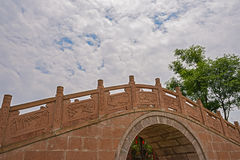 Chinese stone bridge in cloudy summer sky Stock Images