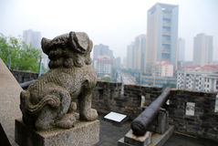 Chinese Stone Carving. Chinese lion stonecarving in modern metropolis Stock Image