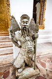 Chinese stone guardian statue in Wat Pho Buddhist Temple Bangkok Stock Photos