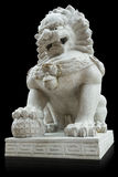 Chinese Stone Lion on black background Royalty Free Stock Image