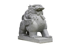 Chinese Stone Lion isolated on white with clipping path. Chinese Stone Lion sculpture isolated on white with clipping path royalty free stock photos