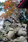 Chinese Stone Lion with maple after Royalty Free Stock Image