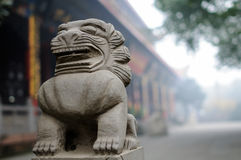 Chinese stone lion in mist Stock Image