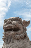 Chinese stone lion. Over blue sky background stock photos