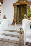 Chinese stone lion statue in the tourist attractionat at Wat Pho Stock Photo