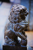 Chinese stone lion. Traditional Chinese stone lion guarding a residence in Beijing Stock Images