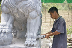 Chinese Stone Sculpturing. Image of a Chinese craftsman sculpturing a stone lion at Guilin, China Stock Photos