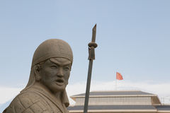 Chinese stone soldier next to china flag Stock Photo