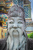Chinese stone statue in Wat Pho, Bangkok, ThailandChinese stone Royalty Free Stock Photo