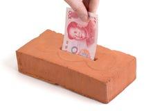 Chinese storting Yuan in een de bouwbaksteen Stock Afbeeldingen