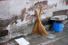 Chinese straw brooms. Some straw brooms leaning against an old brick wall, China stock photos