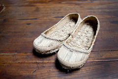 Chinese straw sandals. Old handcraft chinese straw sandals Stock Photography