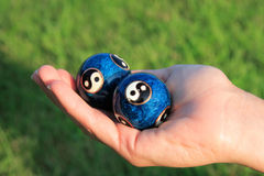 Chinese Stress Balls in Hand. A womens hand holding Chinese anti-stress balls Stock Photo