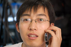Chinese student. A chinese student take a phone Royalty Free Stock Photography