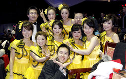 Chinese students cheers after show. Some Chinese college students from Huazhong university of science and technology in Wuhan city cheers after a new year show royalty free stock photo
