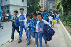 Chinese students go home from school Stock Photography