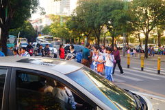 Chinese students home after school through traffic intersection Royalty Free Stock Photo